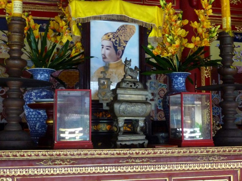 Inside, there is an altar to each Emperor with an image, painting or photo of them.