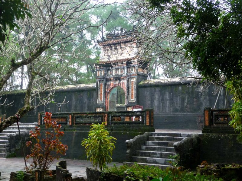 A side view of the Stele Pavilion through the trees.