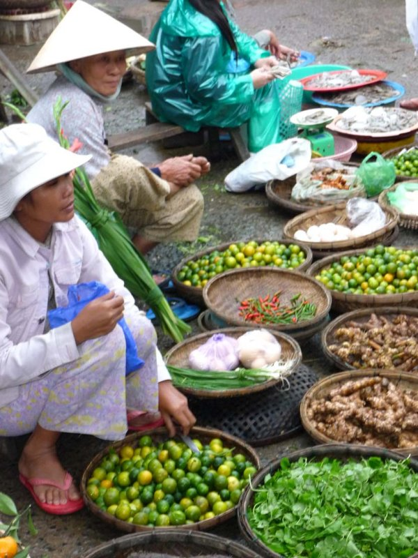 Hoi An women selling fruit and vegetables.