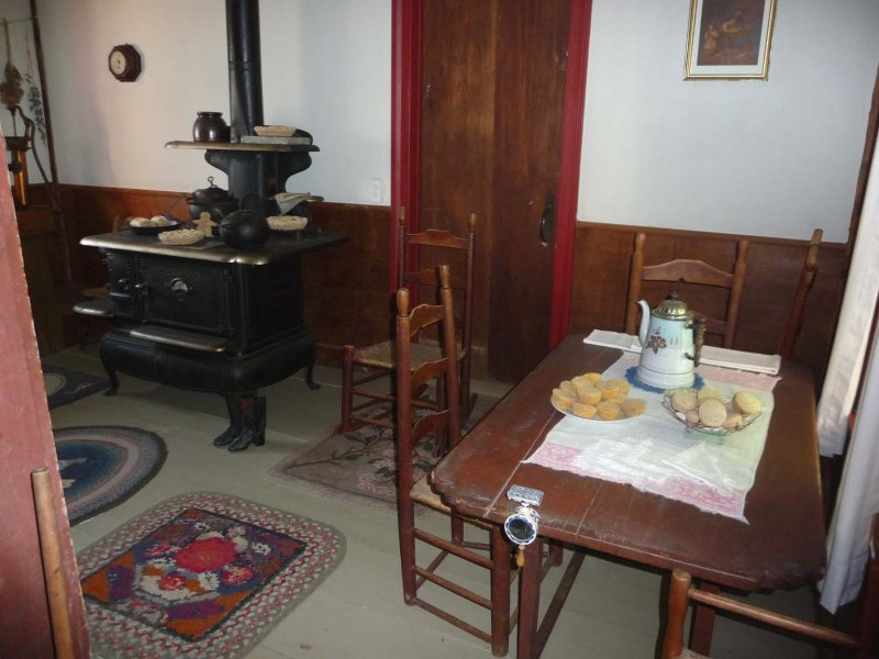 The Kitchen where the family meals were eaten. The table is set the same way it was in 1924 when Calvin took the oath of office.