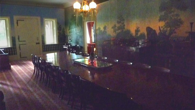 The Main Hall, with French wallpaper and a banquet table, served as a family dining room and for conducting political business.