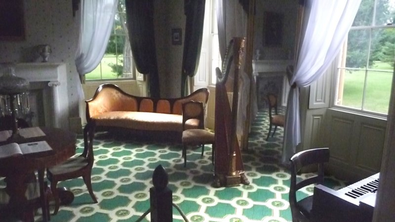 The room contains a harp and an organ.  Music, parlor games and reading aloud filled the evenings at Lindenwald.