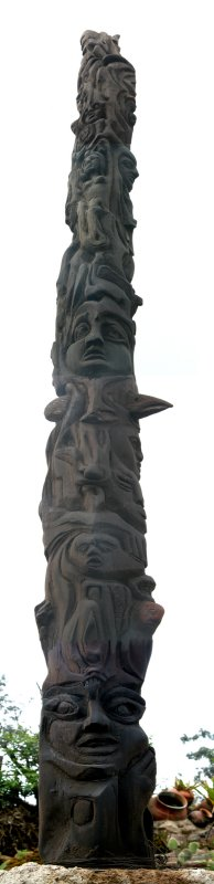 Totem pole where the eagles beak points to the Cayambe Volcano located in the Ecuadorian Andes.