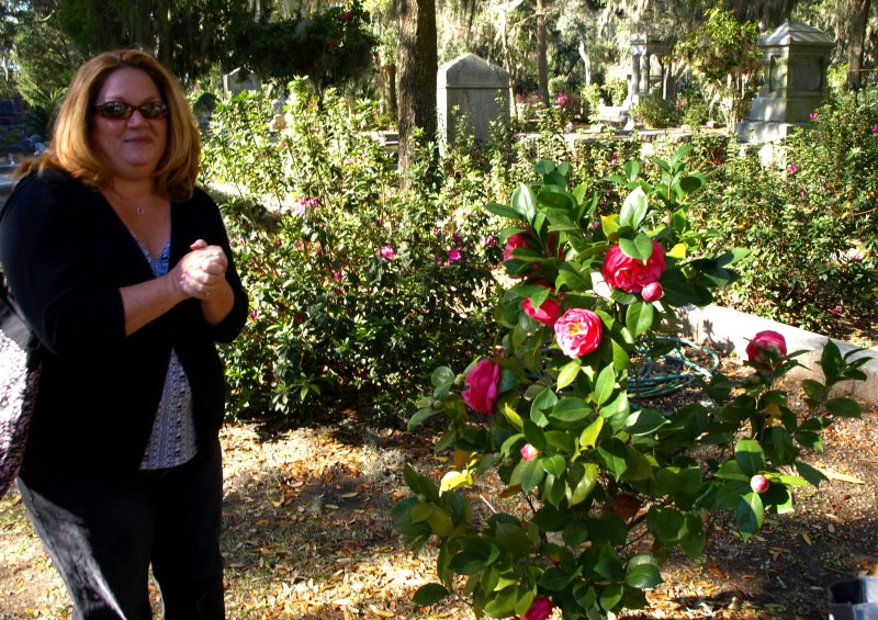 Kathy and her favorite camelia bush
