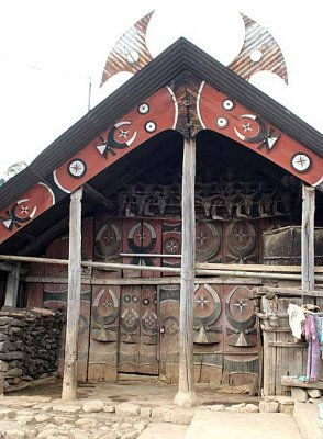 House in Kigwema. The horns on top of the roof show that its owner gave a feast of merit for the villagers.