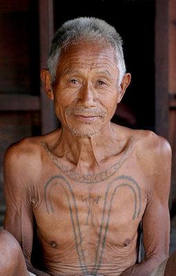 Another Khiamniungan Naga in Nokyan with tattoos of a successful headhunter.