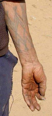 Woman´s tattoos in Wanching.