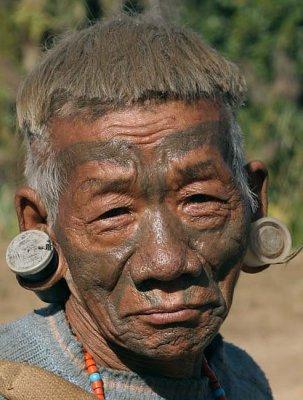Konyak Naga with tattoos of a successful headhunter in Shangnyu.