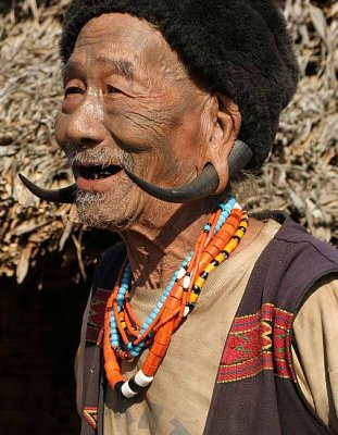 Konyak Naga with tattoos of a successful headhunter near Shangnyu.