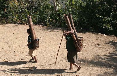 Two women on the Burmese side of Longwa have fetched water.