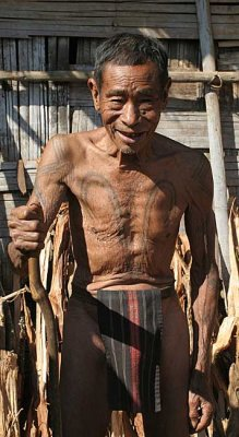 Khiamniungan Naga in Nokyan with tattoos of a successful headhunter.