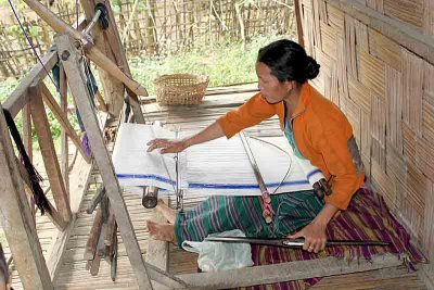 Tangsa lady weaving on her porch