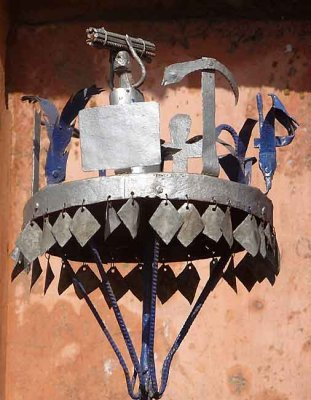 Voodoo. Asen,  a metal pole with images from the life of a forefather, made in  honour of the ancestor.