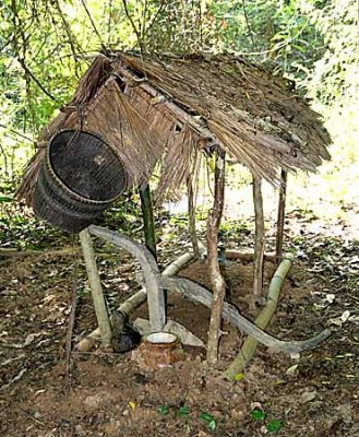 Temporary grave with plough and basket in Kachork graveyard, Cambodia.