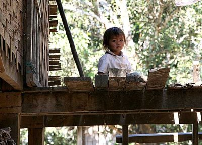 Girl on a porch in Koh Peak, Cambodia.