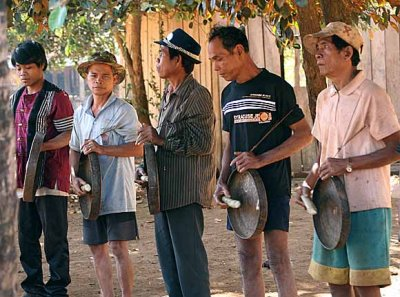 Kreung men playing the gongs. Beginning of harvest celebration in Kameng, Cambodia.