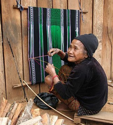 Phnong lady weaving a traditional cloth. Dak Dam Village, Mondulkiri, Cambodia