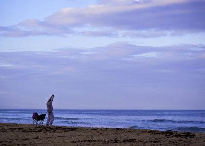 A stretch at dawn, Mission Beach, San Diego, California, 2010