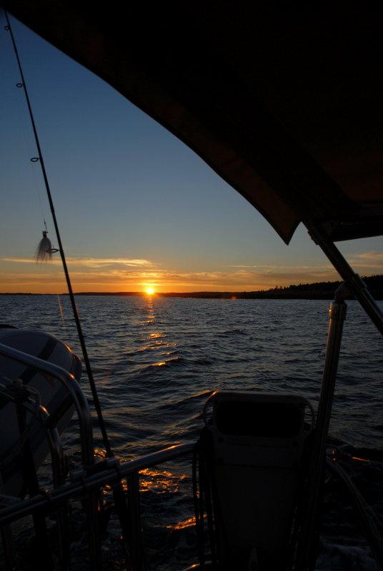 Sun Setting While Sailing