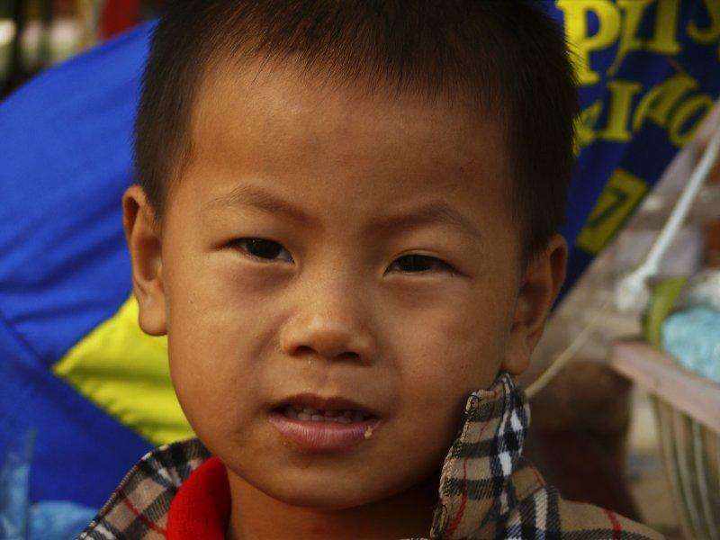 Boy at Vientiane market.jpg