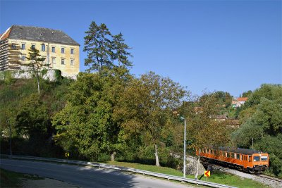 Train passing Ozalj Castle
