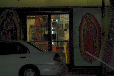 Virgen de Guadalupe at the door of a restaurant with a C rating, Echo Park, CA