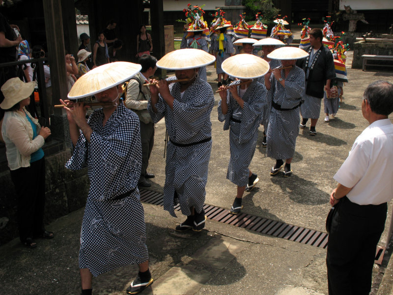 Flute players proceeding in a line