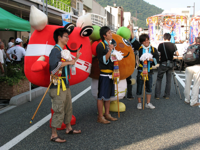 Posing with the town mascots