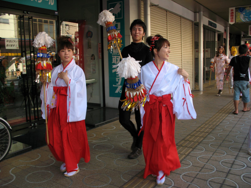 Girls dressed as shrine staff