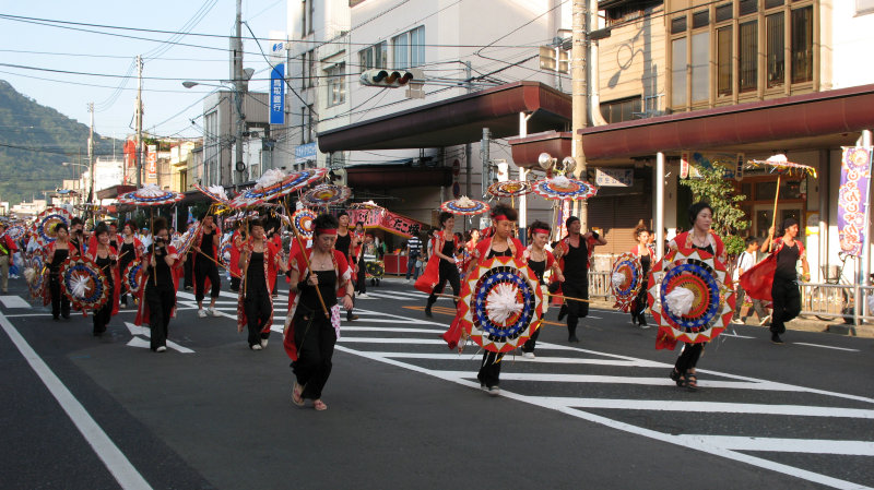 Another group of dancers runs up