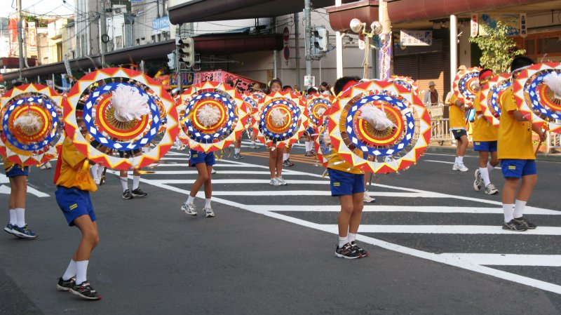 Group of youthful dancers and umbrellas