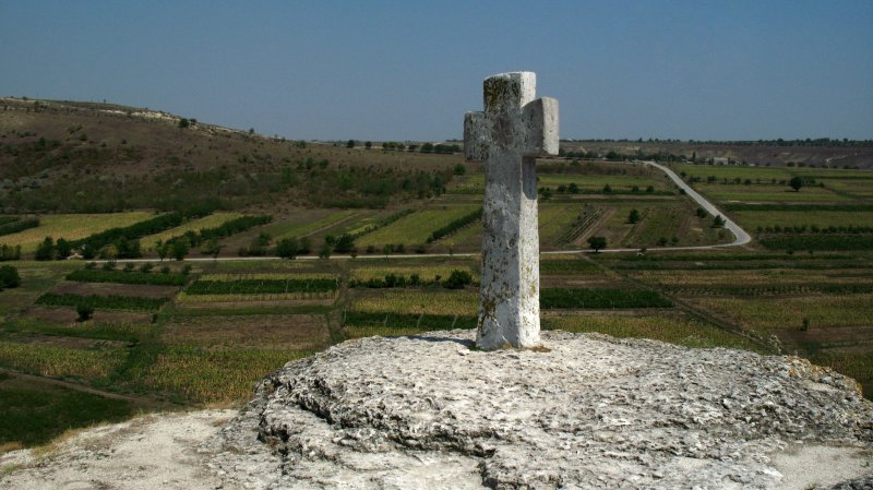 Stone cross and fields beyond