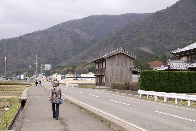 Walking along a windswept road