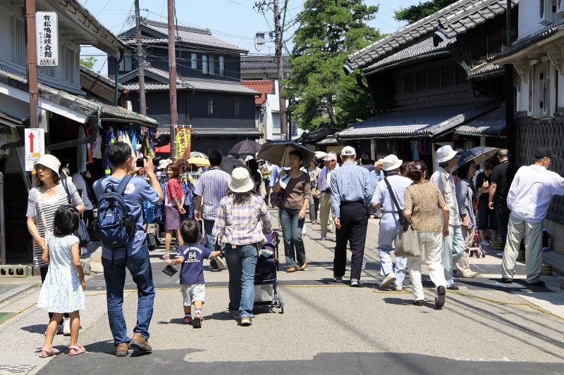 Visitors walking down the historic street