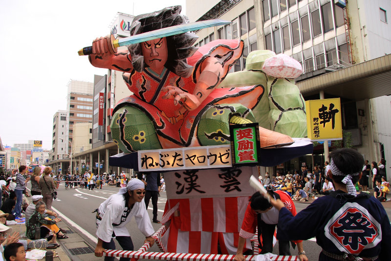 Showing the float to the crowd