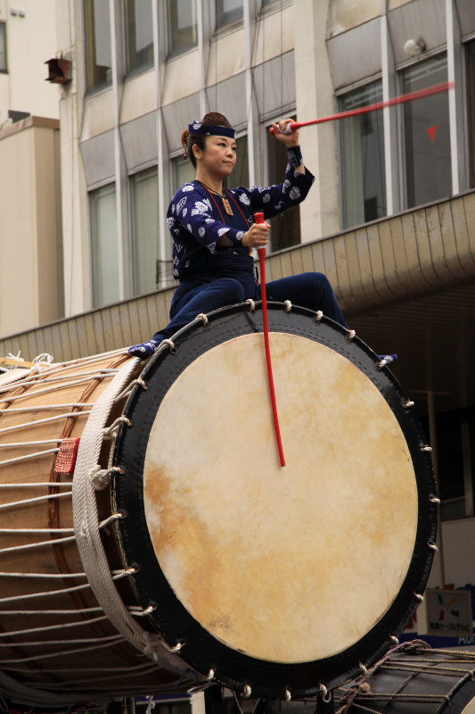 Woman astride a taiko drum
