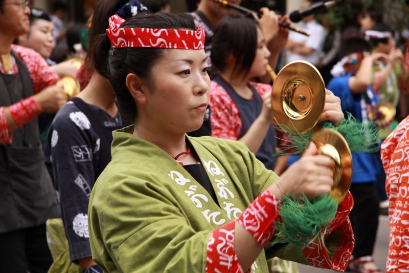 Parade participant with cymbals