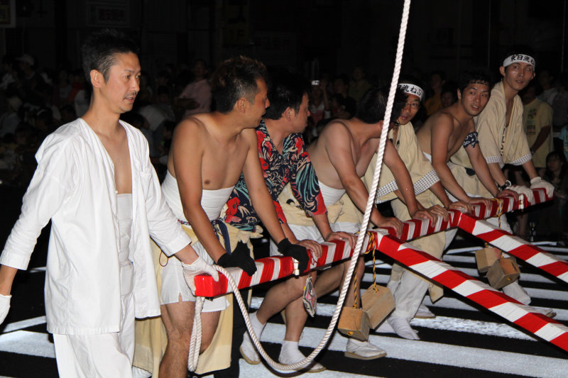 Group of local men pushing a float