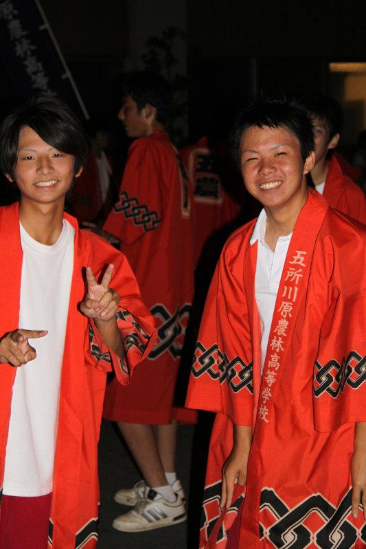 Youths in happi coats
