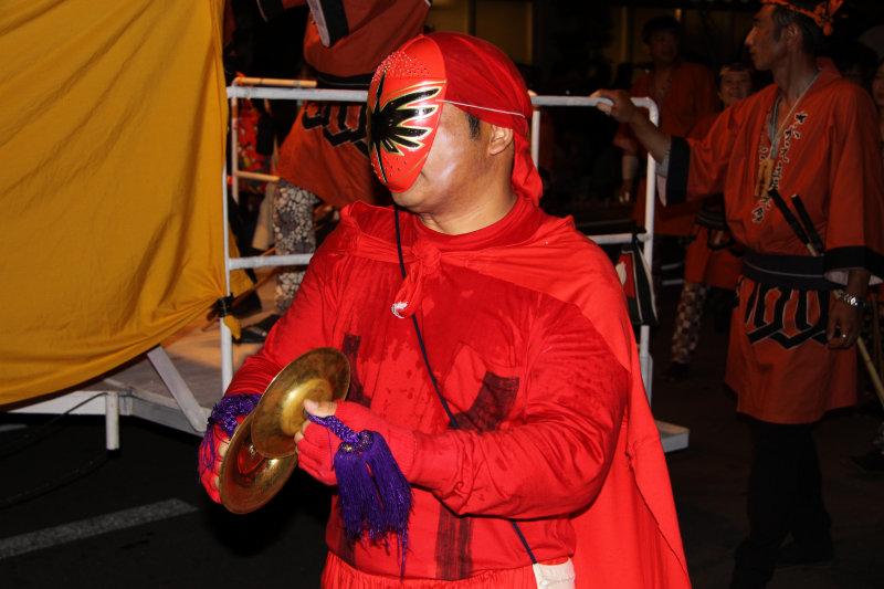 Masked cymbal player
