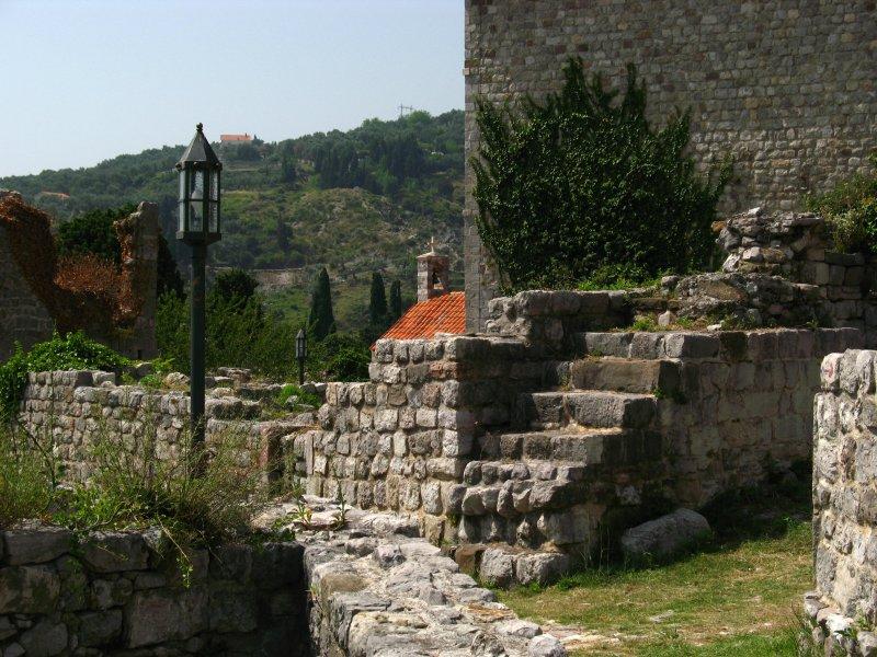 Building corner and distant church, Stari Bar