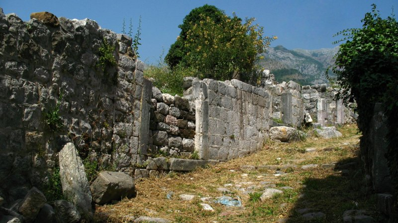 Crumbled stone walls along a footpath