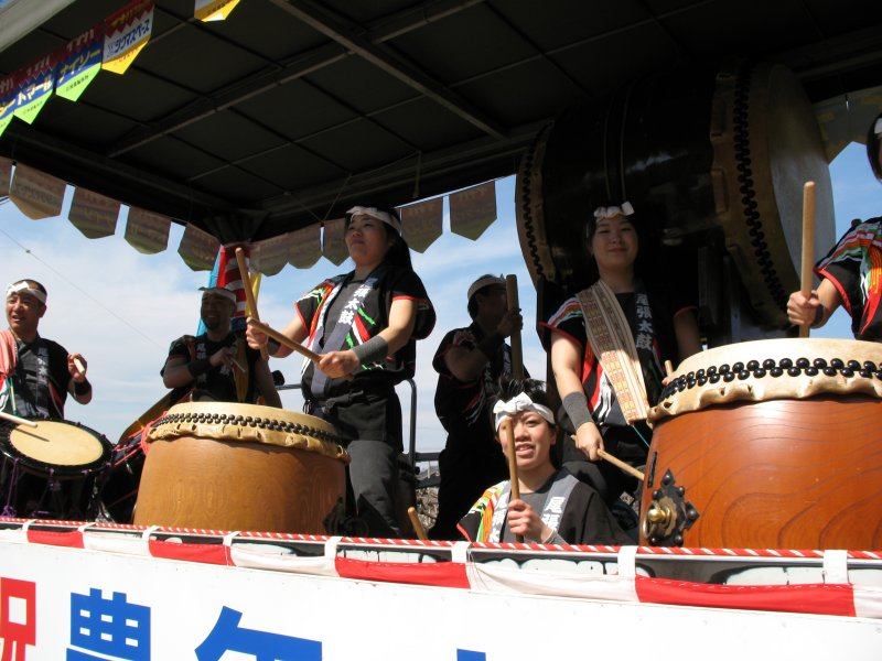 Taiko corps aboard a truck
