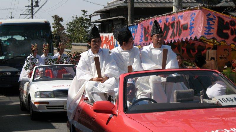 Parade participants riding in