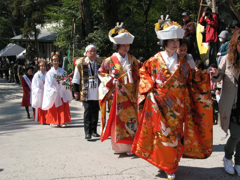 Highly decorated kimono-clad women