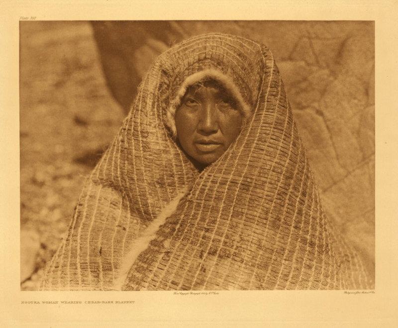 Nootka woman wearing cedar-bark blanket
