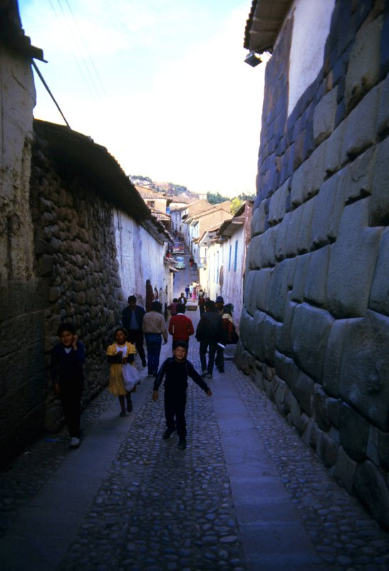 A narrow street in Cuzco . On both sides original Inca architecture.