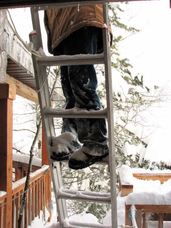 Deborah Clearing Snow from Roof IMG_0804.jpg