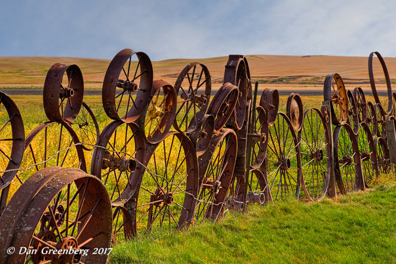 Fence of Antique Tractor Wheels