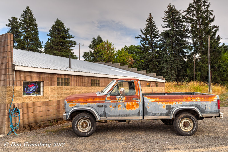 Old Ford Pickup by a Liquor Store
